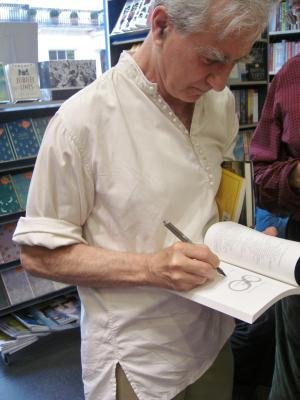 Gabriel Josipovici signing a copy of his new novel